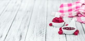 Fresh made Raspberry Jam. On a vintage background as detailed close-up shot Royalty Free Stock Images