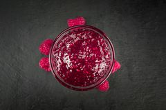 Fresh made Raspberry Jam. On a vintage background as detailed close-up shot Royalty Free Stock Image