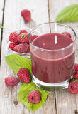 Fresh made Raspberry Juice. With fresh fruits on wooden background Royalty Free Stock Photo