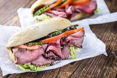 Fresh made Sandwich (with Roast Beef). On wooden background (selective focus royalty free stock photography