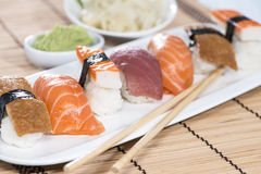 Fresh made Sushi with chopsticks Royalty Free Stock Images