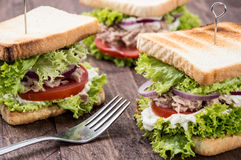 Fresh made Tuna Sandwiches on wood Royalty Free Stock Photo