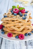 Fresh made Waffles with mixed Berries and Honey royalty free stock images