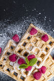 Fresh made Waffles with Raspberries Royalty Free Stock Images