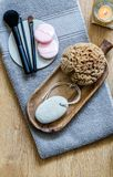 Fresh makeup, natural sponge with zen candle for beauty massage Royalty Free Stock Photos