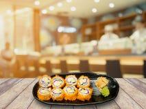 Fresh maki sushi on wood table over japanese restaurant Stock Photos