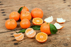 Fresh mandarin oranges fruit with leaves in old wooden table Stock Photo