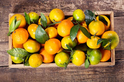 Fresh mandarin oranges fruit  in wooden box Royalty Free Stock Photos