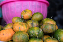 Fresh mandarin oranges on local food organic market, Bali island, Indonesia. Fresh mandarin oranges on local food organic market, Bali island Royalty Free Stock Image