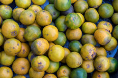 Fresh mandarin oranges on an organic food market of tropical Bali island, Indonesia. Mandarin background. Fresh mandarin oranges on an organic food market of Royalty Free Stock Photography