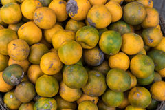 Fresh mandarin oranges on an organic food market of tropical Bali island, Indonesia. Mandarin background. Fresh mandarin oranges on an organic food market of Royalty Free Stock Images