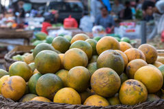 Fresh mandarin oranges on an organic food market of tropical Bali island, Indonesia. Mandarin background. Fresh mandarin oranges on an organic food market of Stock Images