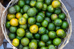 Fresh mandarin oranges on an organic food market of tropical Bali island, Indonesia. Mandarin background. Fresh mandarin oranges on an organic food market of Stock Photography