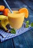 Fresh mandarin smoothie with banana and yoghurt Stock Photo