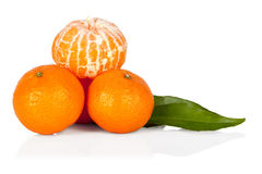 Fresh mandarine tangerine with leaves and segments  on w Stock Photos