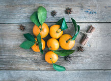 Fresh mandarines with cinnamon sticks and anise stars over a rou Stock Photo