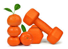 Fresh mandarines with dumbbells Royalty Free Stock Photo