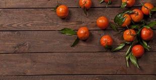 Fresh mandarines on old wooden table Stock Image