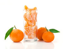Fresh Mandarins. Fresh Tangerine and Segments in a Glass Isolated on White Stock Photos