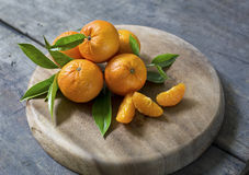 Fresh mandarins. Fresh mandarin with leaves on wooden board royalty free stock image