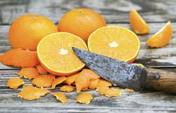 Fresh mandarins with a rustic knife stock photography