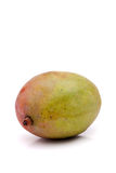 Fresh Mango Fruit. A fresh whole mango fruit isolated over white Stock Image