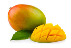 Fresh mango fruit with cut and green leafs Royalty Free Stock Images