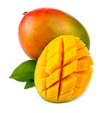 Fresh mango fruit with cut and green leafs isolated Royalty Free Stock Images