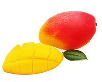 Fresh mango fruit with cut and green leaves isolated on white ba Royalty Free Stock Image