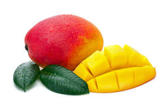 Fresh Mango Fruit with Cut and Green Leaves Isolated on White Ba Royalty Free Stock Photo