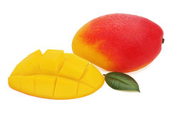 Fresh mango fruit with cut and green leaves isolated on white Royalty Free Stock Photography