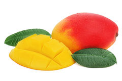 Fresh mango fruit with cut and green leaves isolated on white. Royalty Free Stock Image