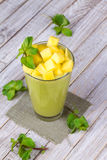 Fresh mango fruit juice in a glass and slices of mango Royalty Free Stock Images