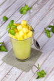 Fresh mango fruit juice in a glass and slices of mango Stock Photo