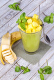 Fresh mango fruit juice in a glass and slices of mango. Close-up. Studio photography Royalty Free Stock Photography