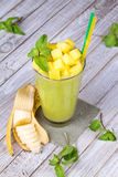 Fresh mango fruit juice in a glass and slices of mango Royalty Free Stock Image
