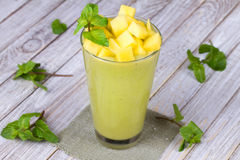 Fresh mango fruit juice in a glass and slices of mango Stock Photography
