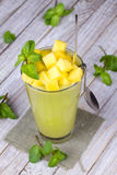 Fresh mango fruit juice in a glass and slices of mango Royalty Free Stock Photography