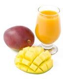 Fresh mango and glass of mango juice Stock Photos