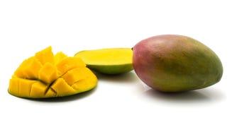 Fresh mango isolated. Sliced mango hedgehog shape isolated on white background two halves one whole Royalty Free Stock Photos