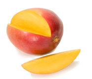 Fresh mango with its yellow slice Stock Images