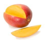 Fresh mango with its yellow slice Stock Images
