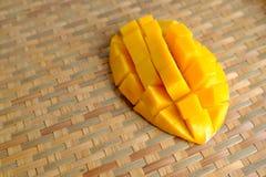 Fresh Mango juice  smoothie  and mango fruit with bamboo basket. Selective focus Royalty Free Stock Photos