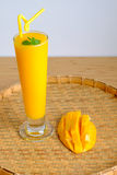 Fresh Mango juice  smoothie  and mango fruit with bamboo basket. Selective focus Royalty Free Stock Images