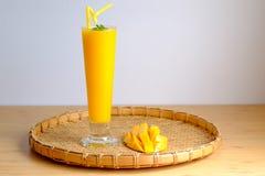Fresh Mango juice  smoothie  and mango fruit with bamboo basket. Selective focus Royalty Free Stock Photo