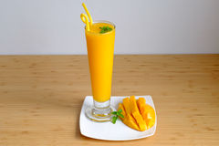Fresh Mango juice  smoothie  and mango fruit with bamboo basket. Selective focus Stock Photography