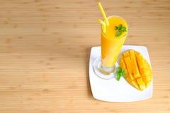 Fresh Mango juice  smoothie  and mango fruit with bamboo basket. Selective focus Stock Photos