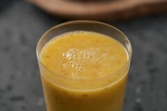 Fresh mango lulo smoothie on kitchen countertop