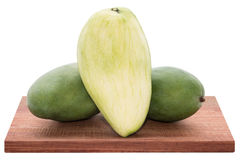Fresh mango - Sliced green mangoes on wooden with isolated white Stock Images