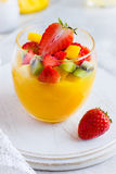 Fresh mango smoothie with fresh fruits and berries Royalty Free Stock Image